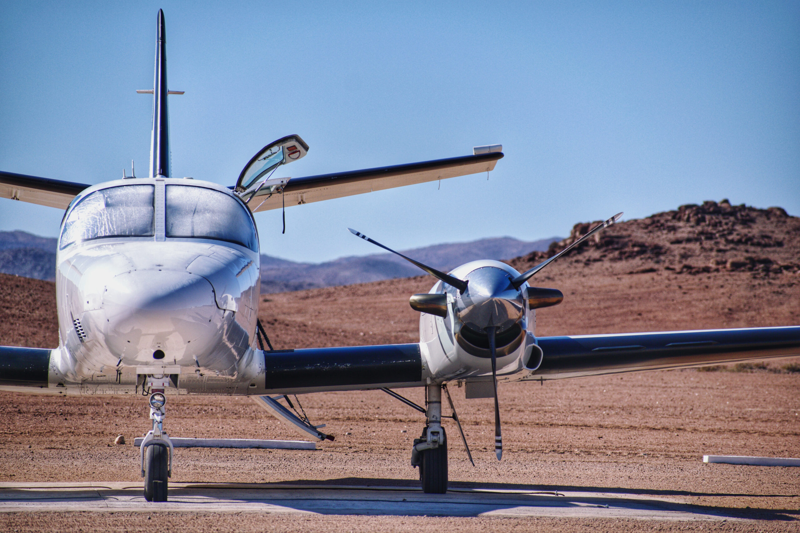 Front,View,Of,An,Aircraft,Parked,With,Desert,Background